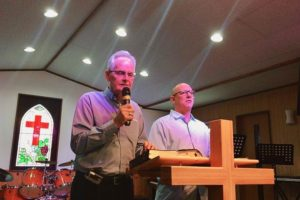 Nils interprets for Jeff Earlwyine in Japan at Munakata Bethel Christian Center on November 20, 2016, one week after Nilw & Andrea passed the baton of pastoral leadership to Jim & Tracy Xavier.